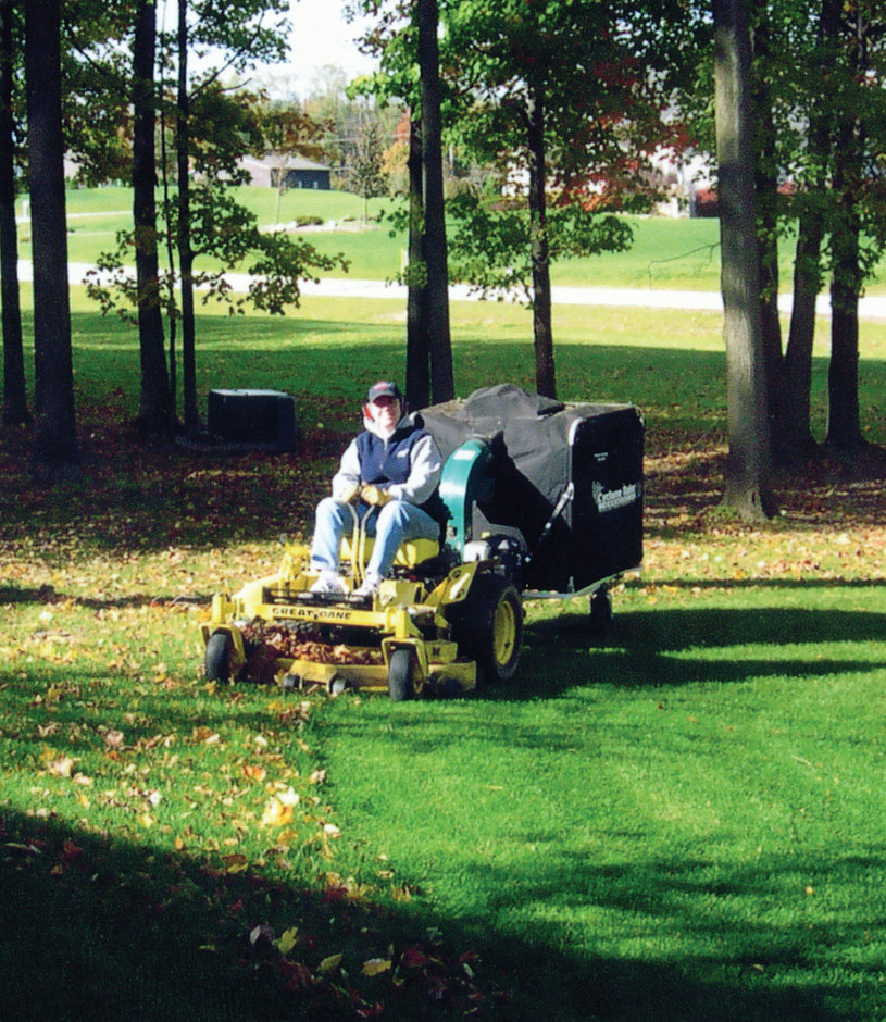 A Cyclone Rake commercial lawn vac is working hard. It's the best professional leaf removal equipment you can buy.